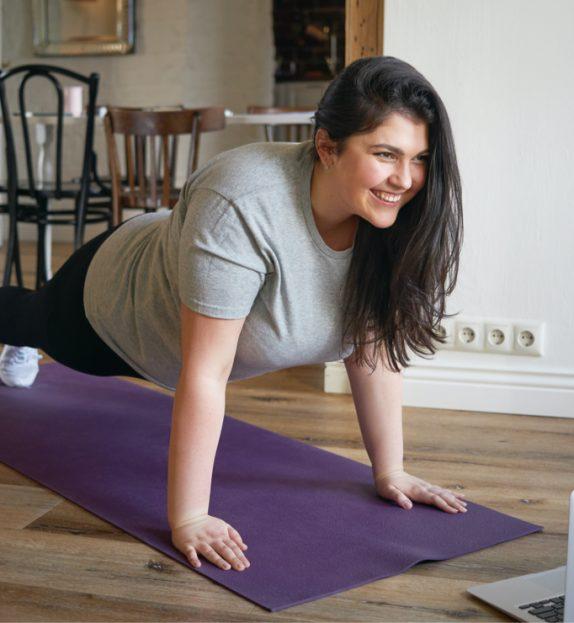 woman planking watching laptop